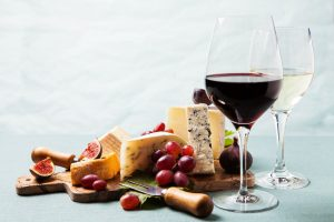 Glass of wine a variety of Cheeses